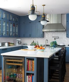 White kitchen with blue cabinets and white counters | Got a small window of free time? Use it to declutter your cookspace in a flash by unloading these extraneous items.