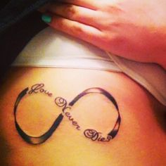 "My first infinity tattoo. ""Love Never Dies"" on the ribs! #infinity #tattoo"