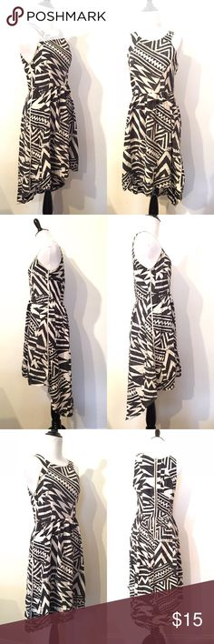 """Sam&Lavi S black/white high low boho hippie dress Amazing find  Perfect for the summer festival  Season -  The inside is a darker pattern than the outside  Exposed gold black zipper  Racer back  High hem at the front - longer at the back  Scoop Neck  One spot i now see in Pattern- see image   Pit to pit : 17""""  Waist: 13.5""""  Collar to back hem : 40"""" sam&lavi los angeles Dresses High Low"""