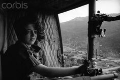 Army nurse 1st Lt. Sharon Forman looks out from medical helicopter with hospital below in Qui Nhon, South Vietnam, Feb. 9, 1966. (AP Photo/Eddie Adams)