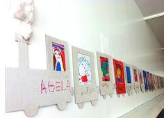 Vagons de tren decorat amb les cares dels alumnes (dibuixades per ells mateixos).