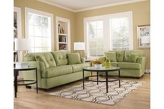 """The Zia Queen Sofa Sleeper from Ashley Furniture HomeStore (AFHS.com). Capturing the true excitement and style of Metro Modern design, the """"Zia-Kiwi"""" upholstery collection awakens any living area with a sleek contemporary beauty along side the plush comfort you've been searching for."""