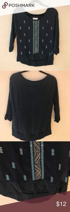 """Hollister Navy Blue Stitched ¾ Sleeve Hi-Lo Shirt Classy, but casual, this ¾ sleeve tee from Hollister is great for a casual fall day or to wear to work!  This top has an intricate gold and blue stitched design, cuffed sleeves, and is high-low, slightly longer in the back than the front.  Most of the top is a thick, opaque material, but the front is sheer.  Excellent used condition with no stains or flaws.   - Size XS (fits a bit larger) - Approx. 18"""" armpit to armpit - Approx. 20.5"""" long in…"""