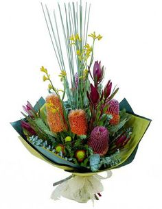 - Balagorang - An impressive and long-lasting bouquet typically including banksia, kangaroo paw and leucadendron, wrapped and tied in natural tones. We deliver anywhere in Australia, including Reservoir, Wodong Flower Bouqet, Bouquet, Australian Native Flowers, Australian Bush, Kangaroo Paw, Native Australians, Flowers Online, Flower Delivery, Ikebana