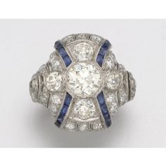 PLATINUM, DIAMOND AND SYNTHETIC SAPPHIRE RING, CIRCA 1925