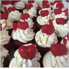 Red Velvet Cupcakes with /whipped cream frosting and chocolate hearts