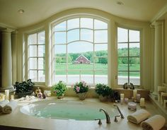 Alluring Built In Bathtub By The White Window With Candles And Small Green Plants Also Towel And Recessed Lamps Decoration Along With Small White Pillars Classic American white house with luxurious interior details Home design http://seekayem.com