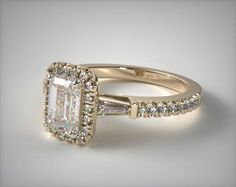 18K Yellow Gold Tapered Baguette Emerald Halo Engagement Ring   An elegant setting for the emerald shape diamond of your choice, hand selected baguettes are perfectly balanced in this tapered halo engagement ring.   Ring Style: 17066Y on JamesAllen.com. Click to view this ring in 360° HD.