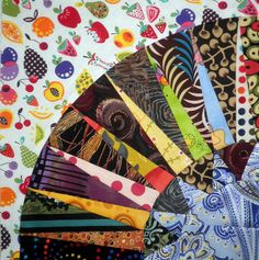 You just don't think about these fabrics going together, do you?  And then they do!  New York Beauty Quilt Along by KimsCraftyApple, via Flickr