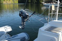 Easy single-handed hoisting of outboard motor to yacht rail (photo: Tod Inlet, Vancouver Island BC) Outboard Motors, Vancouver Island, Sailing, Boats, Easy, Sailing Ships, Candle, Ships, Boat