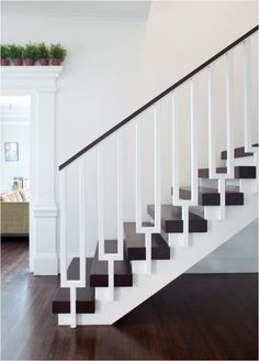 Gorgeous simplicity.  The white railings disappear with the white walls.  Stunning Stair Railings | Centsational Girl