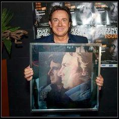 In Antwerpen verast met een platina plaat van Duizend Spiegels. In België vinden ze het album dus ook geweldig.
