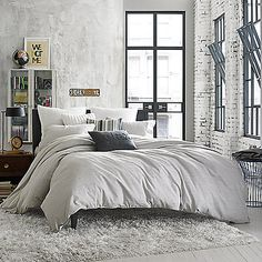 Bring a lived-in look to your bedroom with the Kenneth Cole Reaction Home Element Pillow Sham. Adorned with a soft grey ground, the pillow sham is the perfect finishing touch to the cool and casual be (Cool Bedrooms Grey)