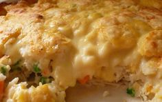 Chicken And Biscuit Bake -- A cross between chicken and dumplings and a pot pie. -- 3 cups (approx.) of cooked, shredded chicken, 1 1/2 cups chicken stock or broth, 1/4 cup butter melted, 2 cups Bisquick, 1 1/2 cups milk, 1 can cream of chicken soup, 1 1/2 cups frozen mixed veggies (allow to thaw for about 30 minutes before adding to recipe), 3 chicken bouillon cubes, Pepper