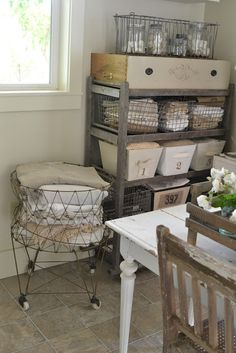 Wire laundry basket & old wood shoe rack for linen storage in Laundry Room. Would also be cute for storing fabrics or craft items in any studio. In my laundry room I want a table so I can just and fold clothes. Downsize a little and perfect Linen Storage, Laundry Room Storage, Laundry Shelves, Laundry Cart, Laundry Craft Rooms, Laundry Bin, Basement Laundry, Mud Rooms, Fabric Storage