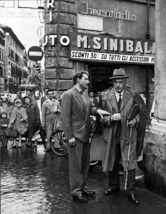 Double Raincoat Weather. Vittorio De Sica, with Domenico...