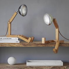 Taking inspiration from the iconic Vespa Scooter, this Danish inspired handmade table lamp collection will add a bit of fun to any space.Iconic in nature, made from beautiful Ashwood, the quality and craftsmanship in this range . G4 Led, Nordic Lights, Wooden Candle Holders, Copenhagen Style, Handmade Table, Black Lamps, Led Lamp, Retro Design, Decoration