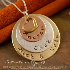 Really like this one too with the different color metals.  http://www.etsy.com/listing/97347160/hand-stamped-mommy-jewelry-personalized