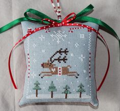 Christmas ornament cross stitch reindeer. Would be nice with pastel ribbons in duck egg blue & pink, or leave the ribbons off! For J x