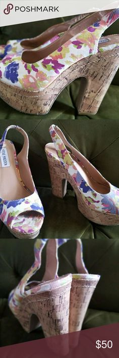 Steve Madden Floral Platforms Chic floral platforms. Love the floral design with a retro cork platform. Ankle strap in the back that has stretch. Condition: EUC ( the inside of the shoe there is some peeling, but no damage on the outside Retail: $100.00 Size: 7M In love with these shoes??... Make an offer or add to a bundle for a private offer Steve Madden Shoes Sandals