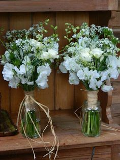 Bridesmaids bouquets with roses and white sweet peas