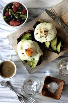 Olive Oil-Poached Eggs on Kale and Avocado Toast | 25 Delicious Ways To Eat Eggs For Dinner