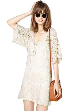 The ultimate neo-retro crochet shift dress is here, and we're all over it.  Features scalloped ne...