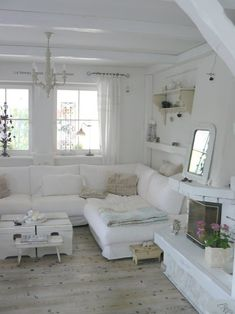 Love the white and broken panel style curtains.