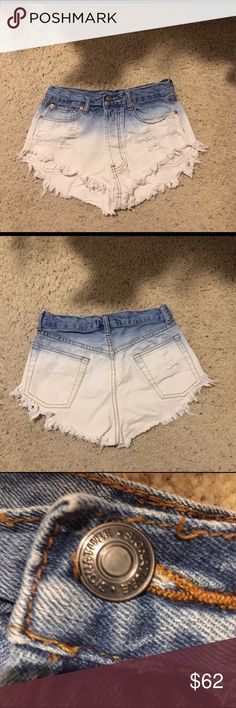 Very sexy ripped jean booty shorts Super sexy and great especially good for the pool or beach/summer. High waisted and beautiful with fade detailing and cuffed endings. Really cute and purchased at Milk boutique in Beverly Hills. Sizes only come in S M L and this one is a S but may possibly fit a XS as well Shorts Jean Shorts