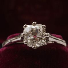 This fabulous early 20th century solitaire is crafted in platinum with a big, perfectly imperfect old mine cut diamond. The 1.41ct gem (L-M/SI2) sits in an eight prong crown setting atop bifurcated shoulders and a slender half round hoop. This ring comes with an EGL diamond certificate and appraisal.    Materials: platinum, 1.41ct old mine cut diamond (L-M/SI2)  Age: c. 1900  Condition: Excellent  Size: US 6.25, can be resized for an additional fee of $90  Location: To see this ring in…