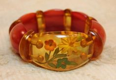 Vintage 1930s Bakelite Book Piece Reverse Carved Floral Link Bracelet is a fabulous reverse carved link bracelet, a book piece featured in several books on bakelite.  This is a book piece in a similar