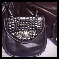 Charming black handbag Various striking textures, silver accents, & rope-braided strap; ALL of my proceeds go to my son who is sick. Bags