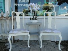 Two stately ladies in neutral white with an accent table in gray!