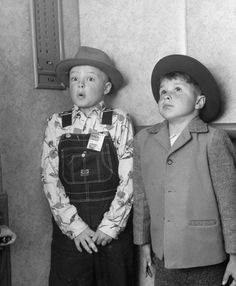 Two boys hold their breath, amazed, on their first elevator ride, 1948.