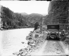pre I-70   View of a car on the Taylor State Road, in Glenwood Canyon (Eagle or Garfield County) Colorado; Denver and Rio Grande Railroad tracks are across the Colorado River. Date1917