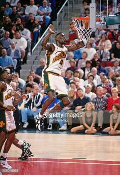 Shawn Kemp Pictures and Photos. Shawn Kemp of the Seattle Supersonics shoots  during a game circa 1996 at Key Arena in Seattle Washington NOTE TO USER ... e79d2a18d