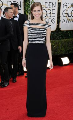 Allison Williams wearing white-and-navy floor-length Alexander #McQueen dress and diamond, onyx, and white gold jewelry by #Cartier – Golden Globe Awards #2014