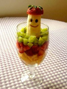 Lots of Clever Fruit Art Ideas on this Site - Pictured: Banana Buddy