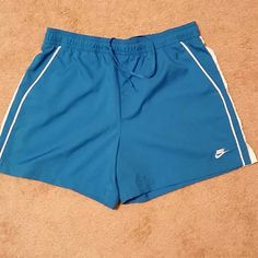 Nike FitDry Shorts Blue with white, size medium, no flaws. Drawstring waist. Front pockets Nike Shorts