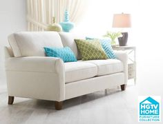 HGTV Home comes to Art Van this Spring with a clean lines and fresh fabrics.  This is a popular choice - the Greenwich Sofa with contrasting pillows.