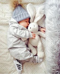 While this baby is so cute and snuggly, mom and dad need to create a safe sleep environment by ridding the area of blankets, toys, pillows, etc. A firm surface for sleep can also help prevent SIDS. // Safe Sleep School //