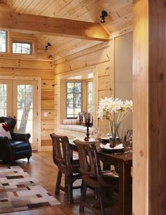 cabin interior .I like the contrast of black leather and dark wood against all the naturals.