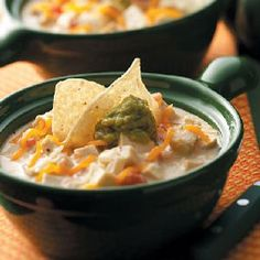 Cheesy Tortilla Soup Recipe -My daughter came up with this dish when trying to duplicate a soup she sampled at a restaurant. I always pass on to her the rave reviews whenever this is served. —LaVonda Owen, Marlow, Oklahoma