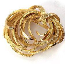 Vintage Gold Tone Signed LISNER Hammered Swirl Round Brooch Pin http://www.ebay.com/itm/Vintage-Gold-Tone-Signed-LISNER-Hammered-Swirl-Round-Brooch-Pin-/131489295102?pt=LH_DefaultDomain_0&hash=item1e9d5f6afe