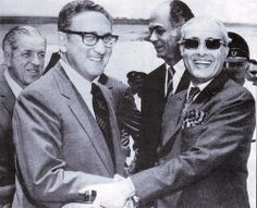 Ambasssador Agha Hilaly played a pivotal role in Henry Kissinger's visit to Peking in July 1971. Joseph Farland the US Ambassador to Pakistan and Sultan M Khan the Foreign Secretary exchange meaningful looks above at Islamabad airport