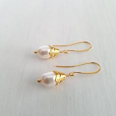 Swarovski pearl earrings, dangle earrings with vintage cap.
