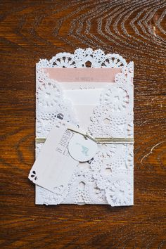Lace wrapped wedding invitation ~  We can create jam, honey favors with beautiful lace toppers to match your theme!  http://www.dasweetzpot.com/
