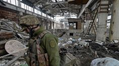 A Ukrainian serviceman guards an area of the government-held town of Avdiyivka near the front line of the war between government troops and Russian-separatist forces in Eastern Ukraine. The protracted war has killed around 10,000 people and displaced close to two million, according to UN figures.