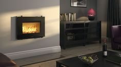 Like a picture of dancing flames on a wall, Hwams range of inset wood burning stoves radiate cosiness and warmth into any home.