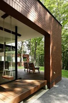 The L shaped building creates a inner private courtyard with the forest edging the plot. The red brick outer and lighter white inner with the closed building pulled a bit further in giving that in between terrace spaces. By atelier137.
